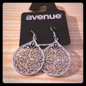 Pair of silver tone dangle earrings from Avenue